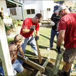 Volunteers installing a wheelchair ramp