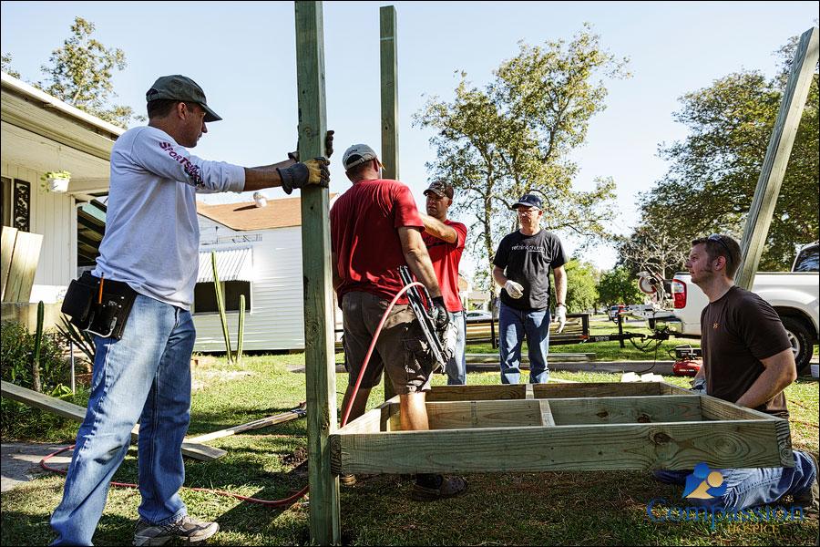 Volunteers installing a wheelchair ramp